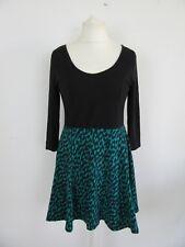 Vestido negro y verde H&M en muy buen estado, talla