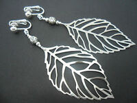 A PAIR OF  BIG  DANGLY SILVER COLOUR  LEAF  CLIP ON EARRINGS. NEW.