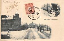 Carte postale CHINE - Une rue de Tientsin - Bébé Chinois