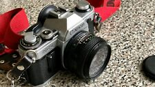 Canon AE-1 35mm SLR Camera with Canon FD 50mm f1.8 Lens and two extra lenses