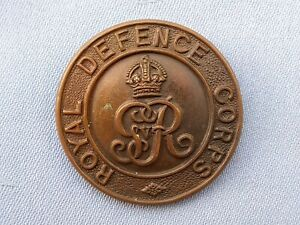 The National Defence Company Officers Service Dress cap badge.