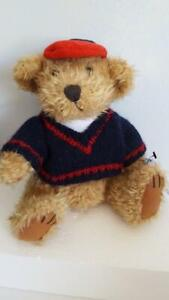 """11"""" PLUSH BRASS BUTTON BEAR TULLY, SWEATER, CAP, JOINTED, LONG HAIR, GLASS EYES,"""
