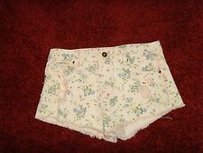 GUC Forever 21 size 26 waist LA CA pink w/ blue flowers distressed denim shorts