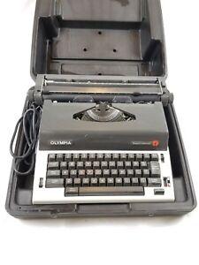 Vintage Olympia Werke AG Report Electric Typewriter w/Black Carrying Case 1982