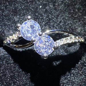 WHITE GOLD FILLED RING WITH SMALL 2 ROUND CUT SIMULATED DIAMOND SIZE R1/2
