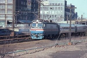 AMTRAK 1981 slide. AEM7 engine 909 in Long Island City by East River tunnels