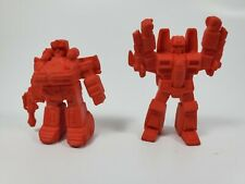 2 Vintage 1980's Red mini Transformers Flexable material.