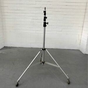 Commercial Manfrotto studio light stand/ tripod with wheels