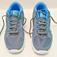 6ab0ef366260 NIKE FLEX TRAINER 4 Women s Size 7.5 Gray with Blue Swoosh Athletic Shoes   329