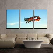 """Wall26 - Red vintage airplane flying against blue sky - CVS - 24""""x36""""x3 Panels"""