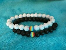 TWO MATCHING BEADED RAINBOW BRACELETS BLACK ONE. WHITE ONE WITH RAINBOW BEAD NEW