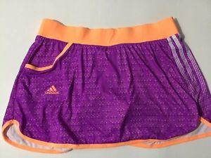 adidas response climalife skorts purple w/orange waist band & polka dots, size M