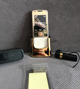 NOKIA 8800 GOLD ARTE WITH A GOLD STAND / GOLD BLUETOOTH HEADSET AND OTHER