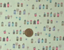 CREAM WITH ROWS OF LITTLE HOUSES IN A VARIETY OF COLOURS- COTTON FABRIC F.Q.'S
