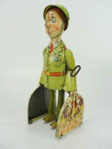 1930'S UNIQUE ART TIN WIND UP G.I. JOE AND THE K-9 PUPS LITHO WALKER TOY