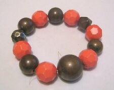 Great elasticated beaded bracelet orange and bronze tone plastic