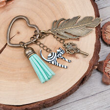 Antique bronze effect feather, cat, key and tassel heart shaped charm keyring