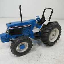 Ford 7740 with  MFWD and  Wide Rear Tires - by Ertl- 1/16th Scale