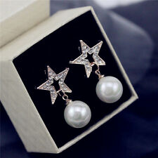 Gold tone crystal star with white hanging pearl stud earrings