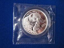 2004  GILDED  1Oz Silver Panda Coin, double sealed.