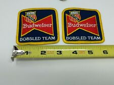 Budwesier Bobsled Team USA Winter Olympics Beer Jacket Shirt Hat Sew Patch VTG