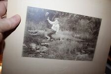 Vintage cabinet photograph of 4 year old boy riding a dead or fake alligator