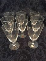 Eight Crystal Goblets with Silver Rimmed Edging.