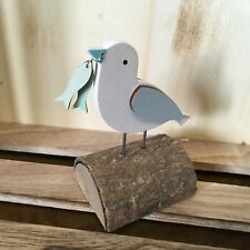 Seagull on a log with fish.Shoeless joe ornament.Wooden ornament. Coastal bird.