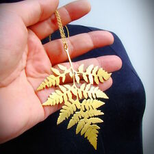 Fern leaf pendant in brass hand sawing