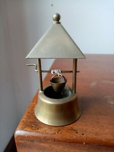 antique or vintage brass wishing well ornament with working handle and bucket