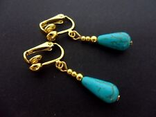 A PAIR OF TURQUOISE BLUE  GOLD PLATED DANGLY TEARDROP CLIP ON EARRINGS. NEW.