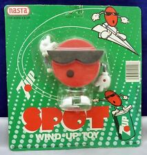 1980'S UNUSED ON THE CARD 7 UP SPOT WHITE KNOB WIND UP TOY