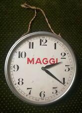 Ancienne petite horloge murale mécanique MAGGI