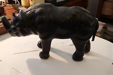"Rhinoceros 6"" tall 12"" long Leather like skin weighs 1.8 lbs"
