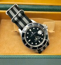 A STEEL ROLEX OYSTER PERPETUAL SUBMARINER 16800 TRANSITIONAL WATCH CIRCA 1987