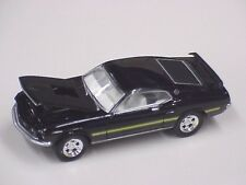 Greenlight Ford 1969 Mustang Mach 1 the car is black with yellow stripe on sides