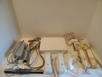 Nintendo Wii Gaming Console 4 Controllers (2 chargeable) 1 Nunchuk, & Cords.