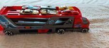 Hot Wheels Mega Hauler Truck, Car Firing carrier and 6 cars