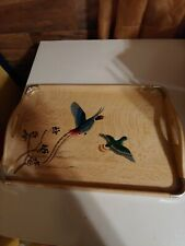 Beautiful wooden serving tray with colorful birds on it
