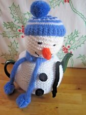 HAND KNITTED SNOWMAN SANTA HAT TEA COSY WITH BLUE STRIPEY HAT.