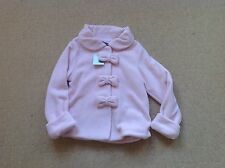 New with tags pink fleece jacket with bow detail in size age 4 - 5 years by Next