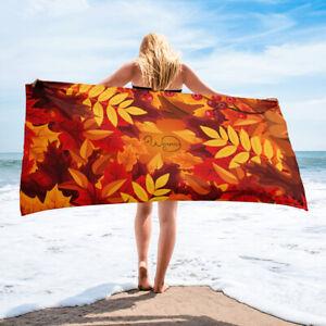 Orange towel, Orange and red autumn leaves, Beach or bathroom