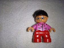 Lego Duplo  - Toddller./Baby wearing a pink top, red pants, a black ball cap