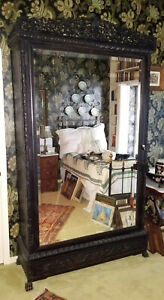 ANTIQUE 19c HEAVILY CARVED ROSEWOOD ARMOIRE with BEVELED MIRROR & PAW FEET