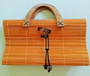 VINTAGE BAMBOO SLAT HANDBAG from the 1980's with wood handles and black lining