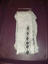 Womens tights light gray with multiple colors on tights size large. *NWOT*