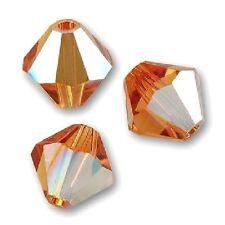 20 Perles Toupies 4mm Cristal Swarovski - TOPAZ AB