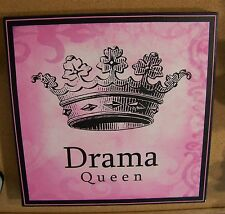 """Drama Queen pink and black printed design stretched over frame about 12"""" x 12"""""""