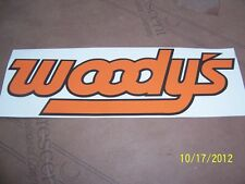"""1- 3"""" X 9"""" WOODY'S Traction Product New Orange with Black outline Vinyl Sticker"""