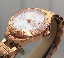 Ladies Guess rose gold plated bracelet watch with day and date (p95)